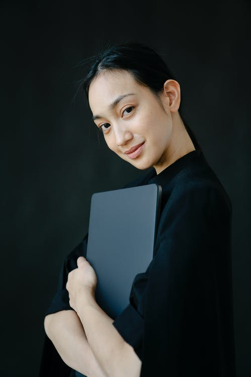 Woman in Black Blazer Holding Gray Tablet Computer