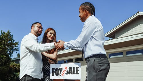 Man Shaking Hands with a Realtor