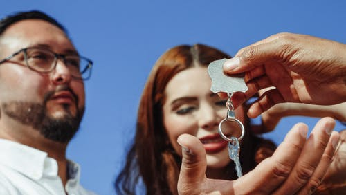 Person Giving a House Key