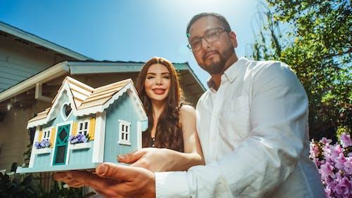 Couple Holding a Miniature House