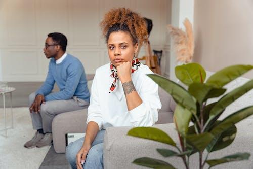 Woman in White Long Sleeves Looking Pensive