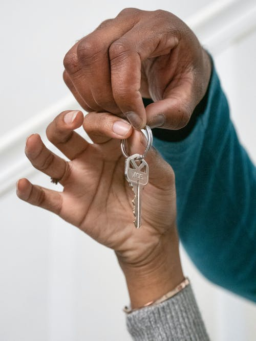 People Holding a Key