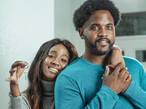 Man in Blue Long Sleeve Shirt Beside a Woman in Gray Knit Sweater