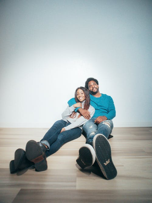 Man and Woman Sitting on the Floor