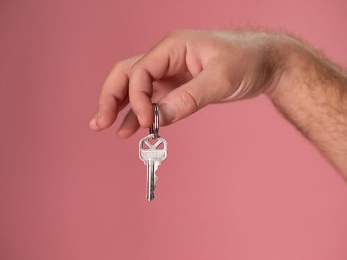 Silver Key on Persons Hand