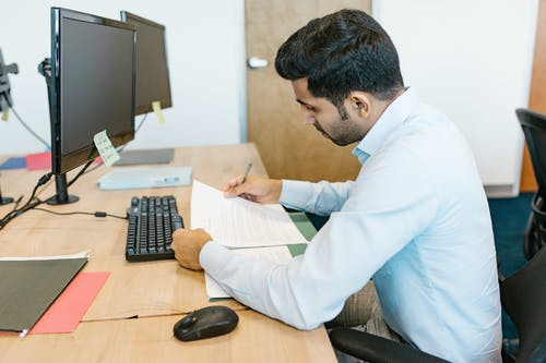 Man in White Long Sleeve Shirt Reading