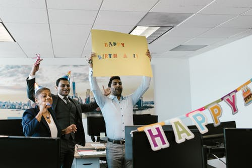 People Surprising their Colleague