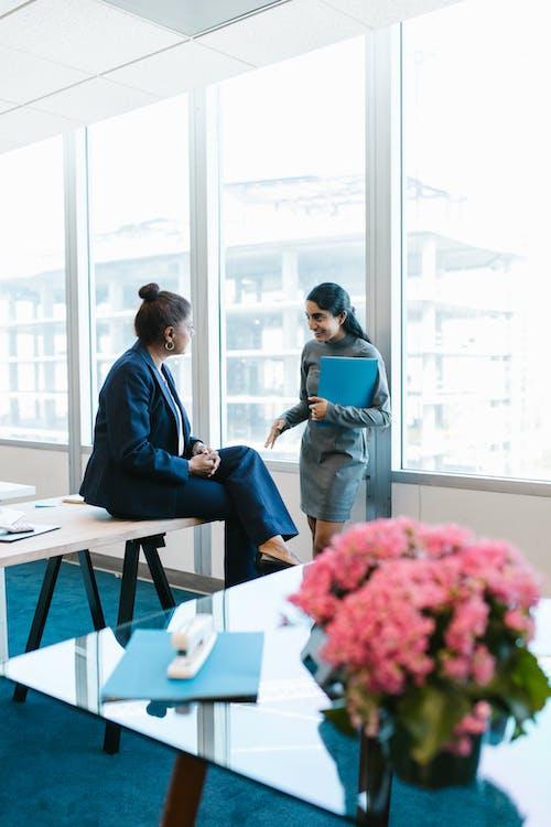Man in Blue Suit Jacket Sitting Beside Woman in Blue Dress