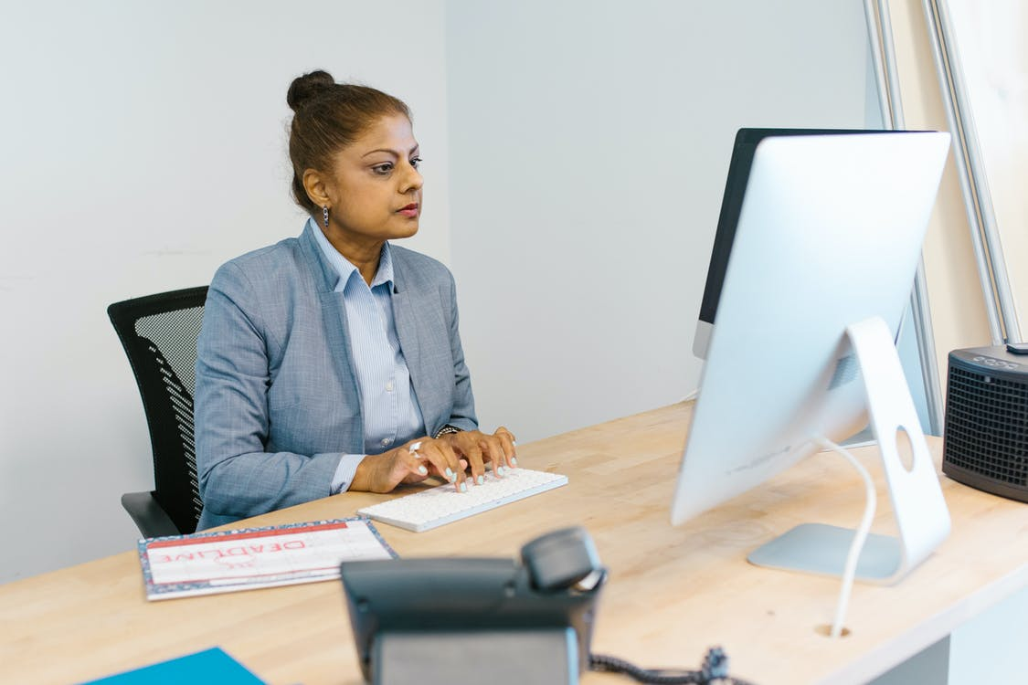 Woman Busy Working in Her Office
