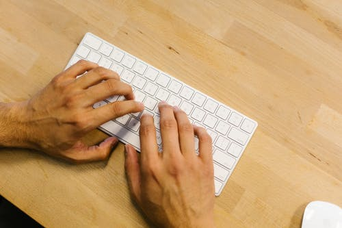 Person Using White Apple Keyboard