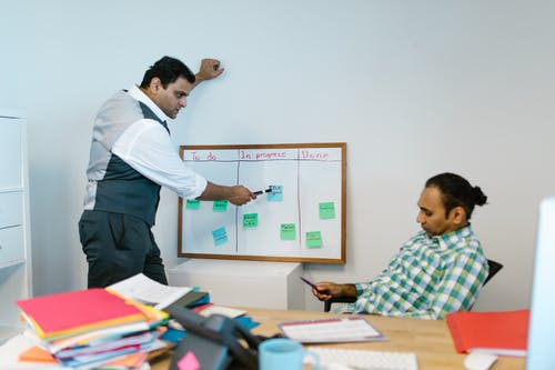 Man Pointing on a Whiteboard