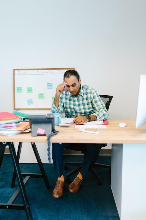 Man Sitting at his Desk Thinking