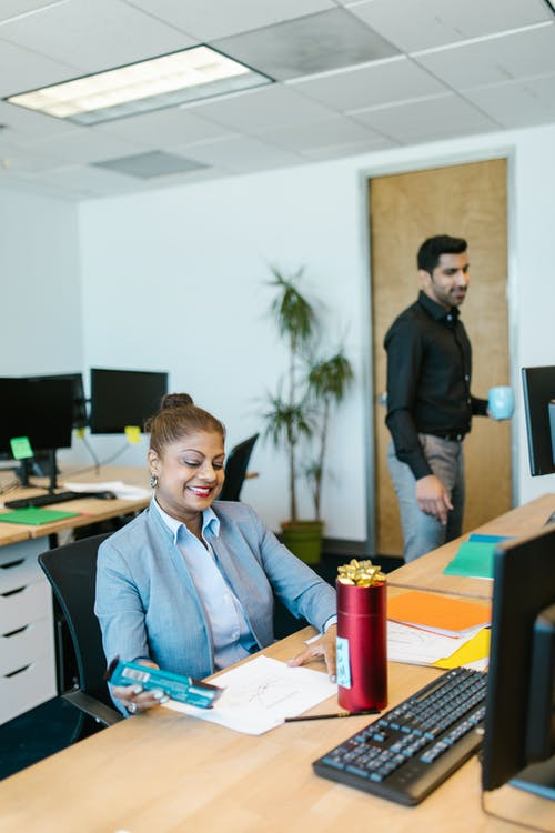 Man and Woman at an Office