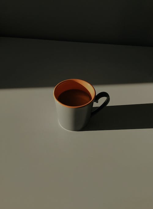 Cup of hot cocoa in sunlight