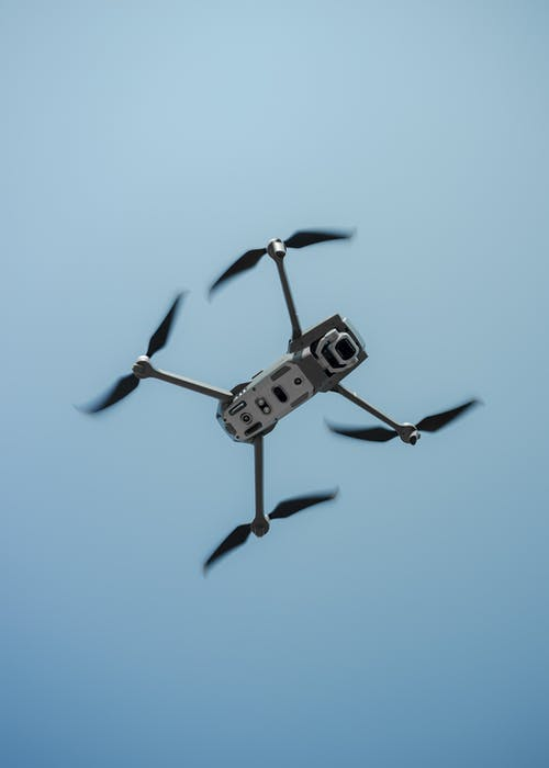 Black and White Drone Flying in the Sky