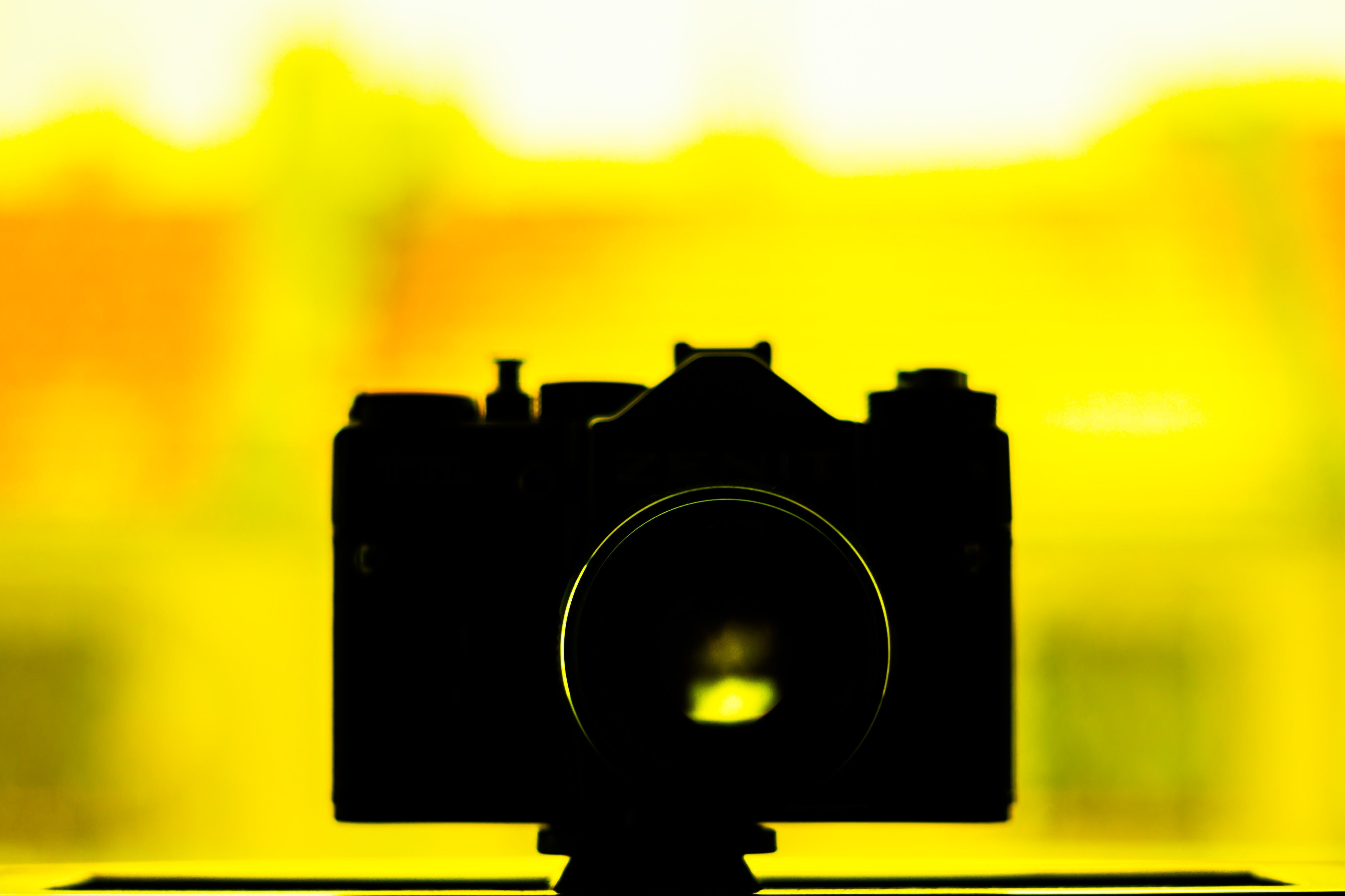 Silhouette Photo of Camera on Yellow Background