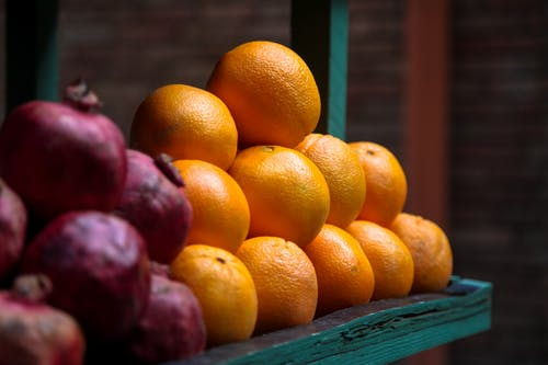 Selective Focus Photo of a Pile of Oranges