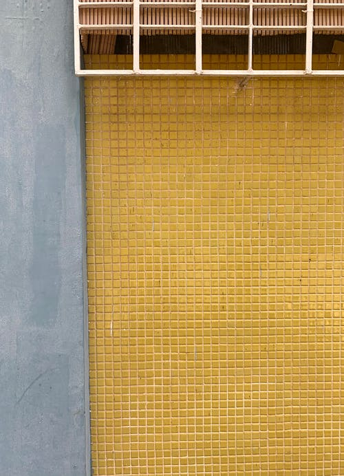 Brown Metal Frame on Gray Concrete Wall