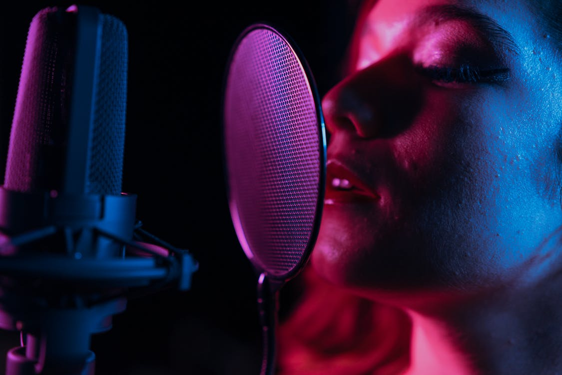 Man Singing in Front of Microphone
