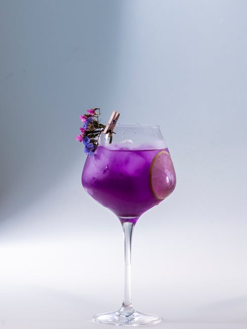 Close-Up Photo of a Purple Drink in a Wine Glass