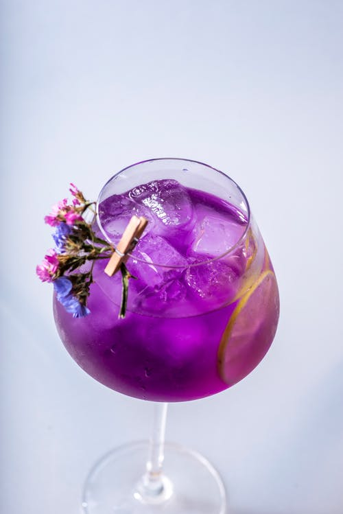 High-Angle Shot of a Purple Drink in a Wine Glass