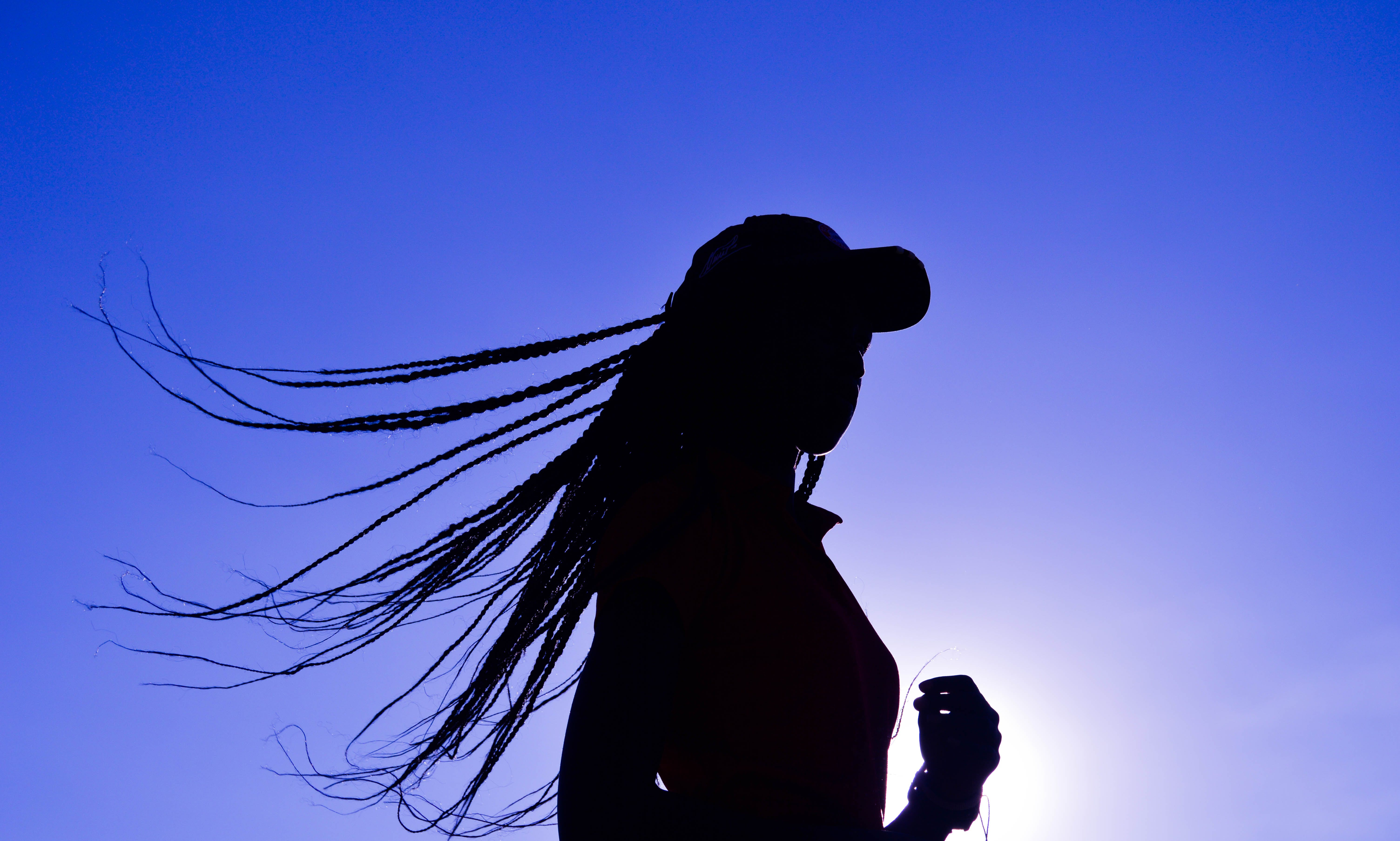 Silhouette of Woman Wearing Cap