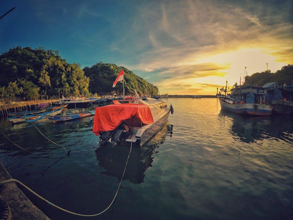 Motor Boat Near Dock during Sunset
