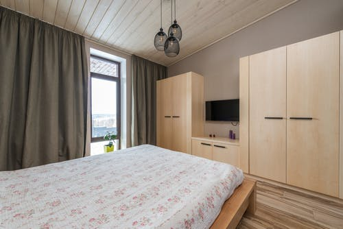 Bedroom with Wooden Cabinets