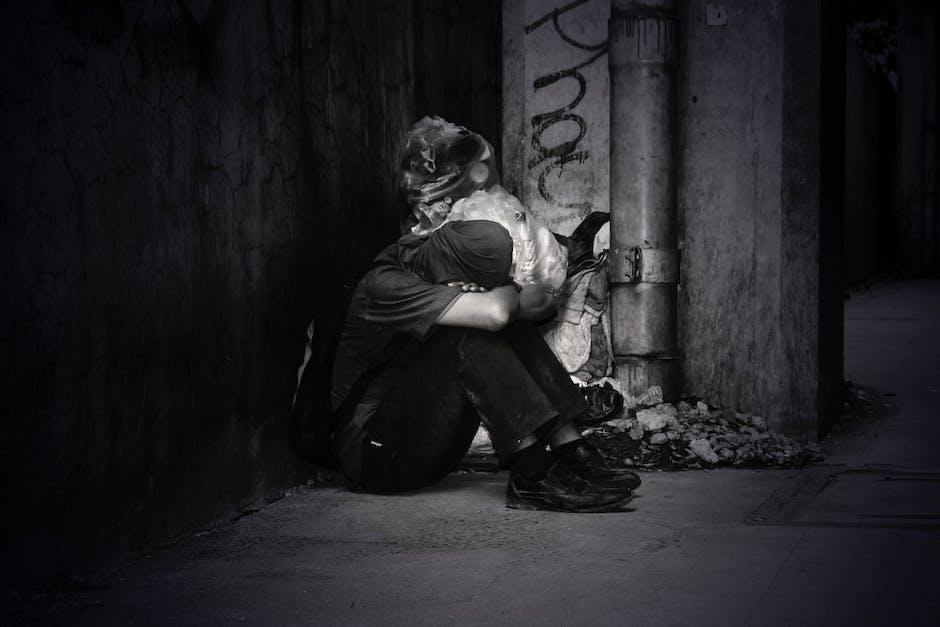 Monochrome Photo of a Homeless Man