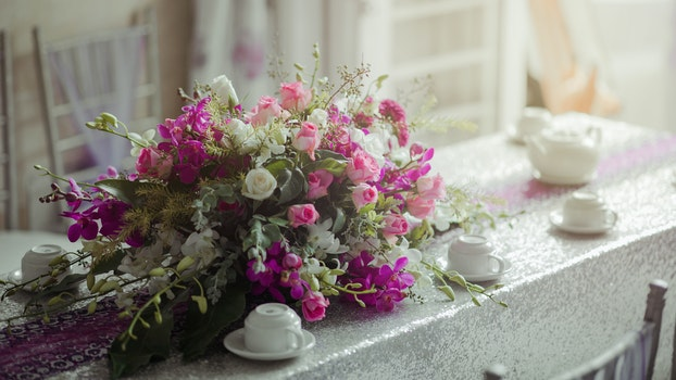 Photography of Flowers near Cups