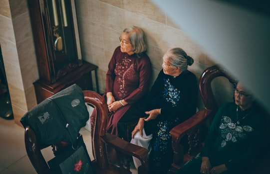 Photography of Three Old Women Sitting on Chair