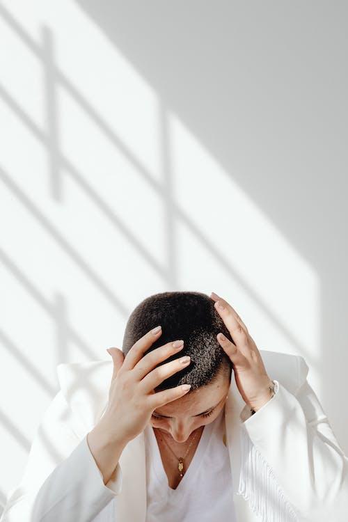 Person Wearing a White Blazer