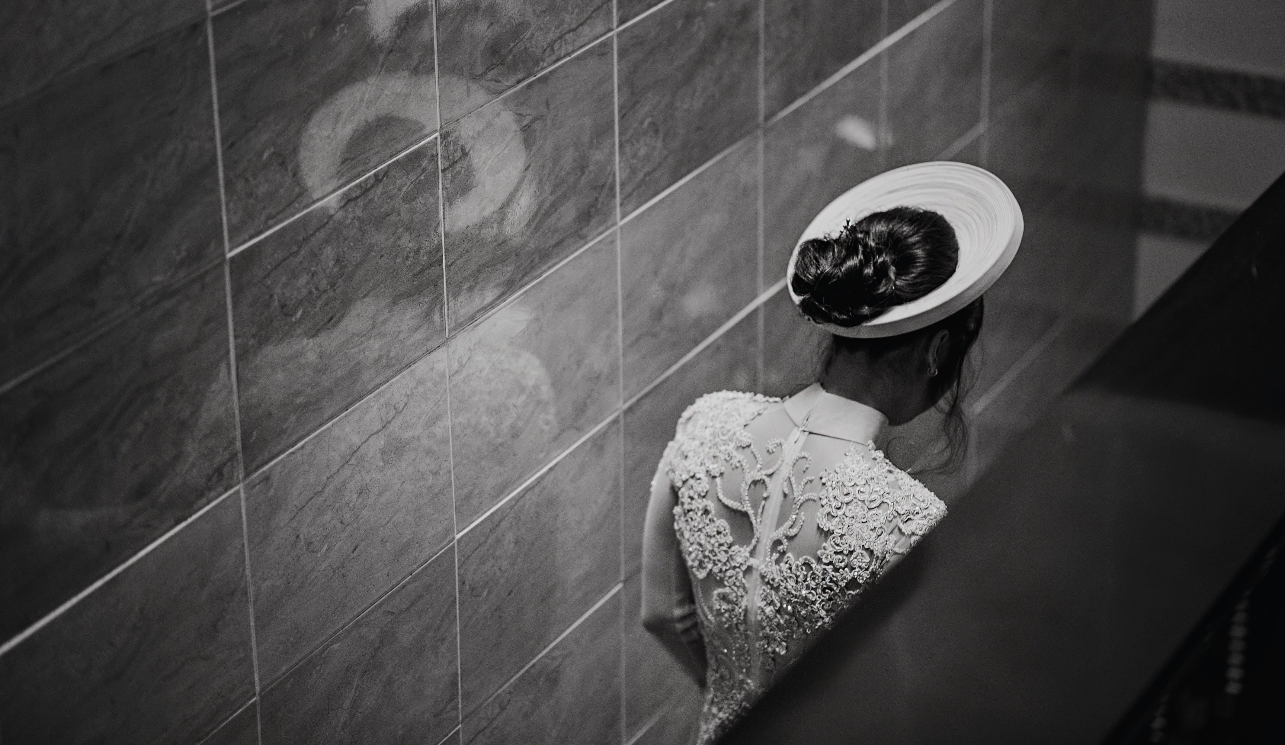 Woman in White Dress Standing Inside Room