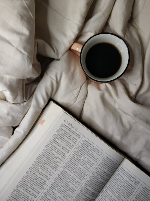 A Cup of Black Coffee Near a Dictionary Book