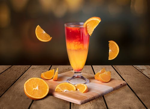 Selective Focus Photo of a Drink with Orange Slices