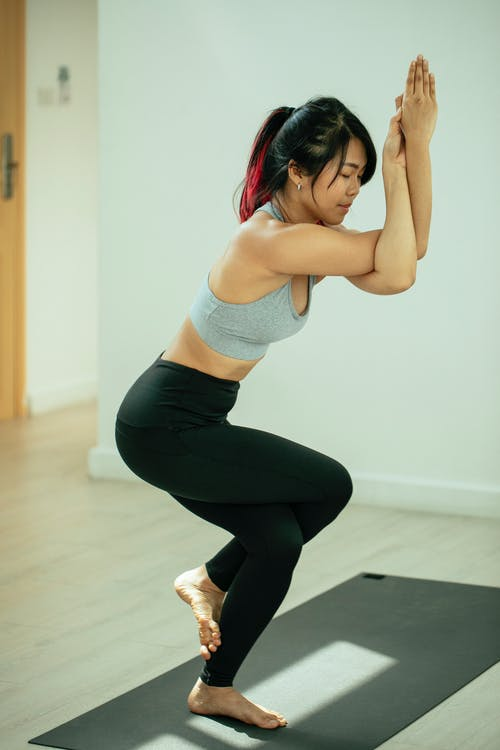 Fit woman doing Eagle pose