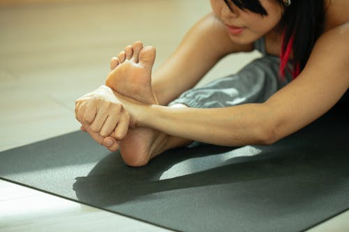 Photo of a Woman Stretching