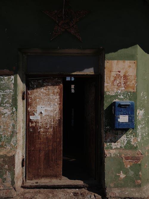 Opened door of old weathered building