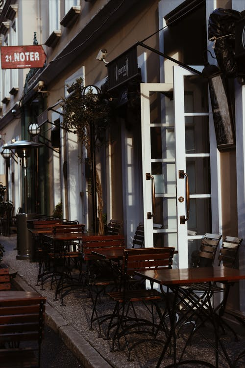 Street cafe with tables and chairs