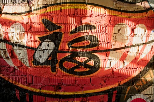 Red and Black Graffiti on Wall
