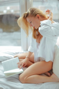Woman in White Shirt Reading Book