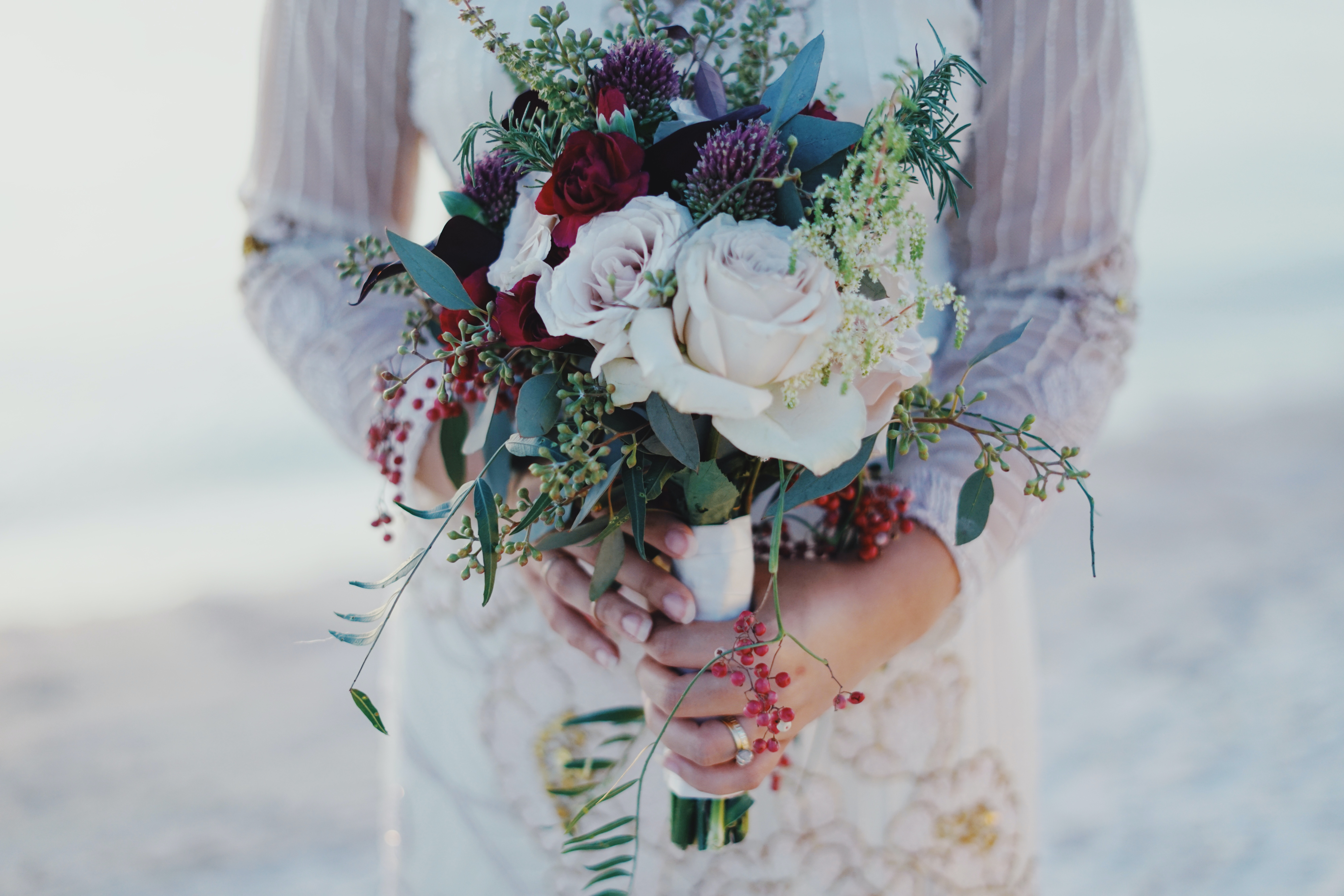 Woman Holding Red And White Rose Bouquet Free Stock Photo