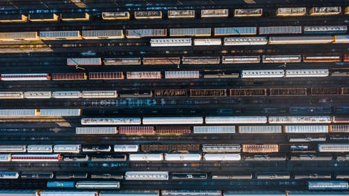 Blue and Brown Train on Rail Track