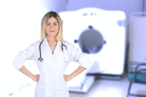 Woman Wearing White Medical Uniform and Stethoscope