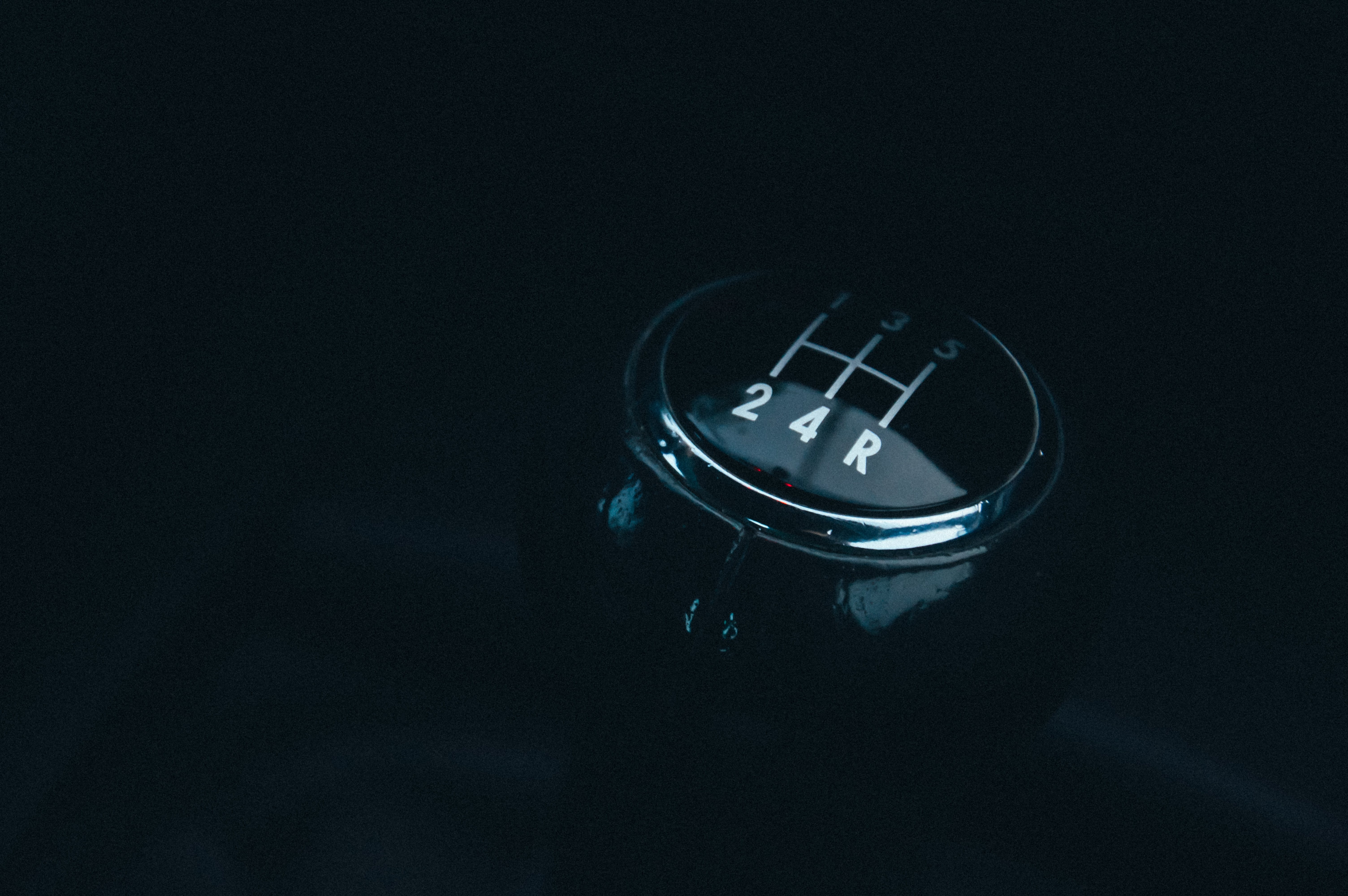 Closeup Photography of Vehicle Gear Shift Lever