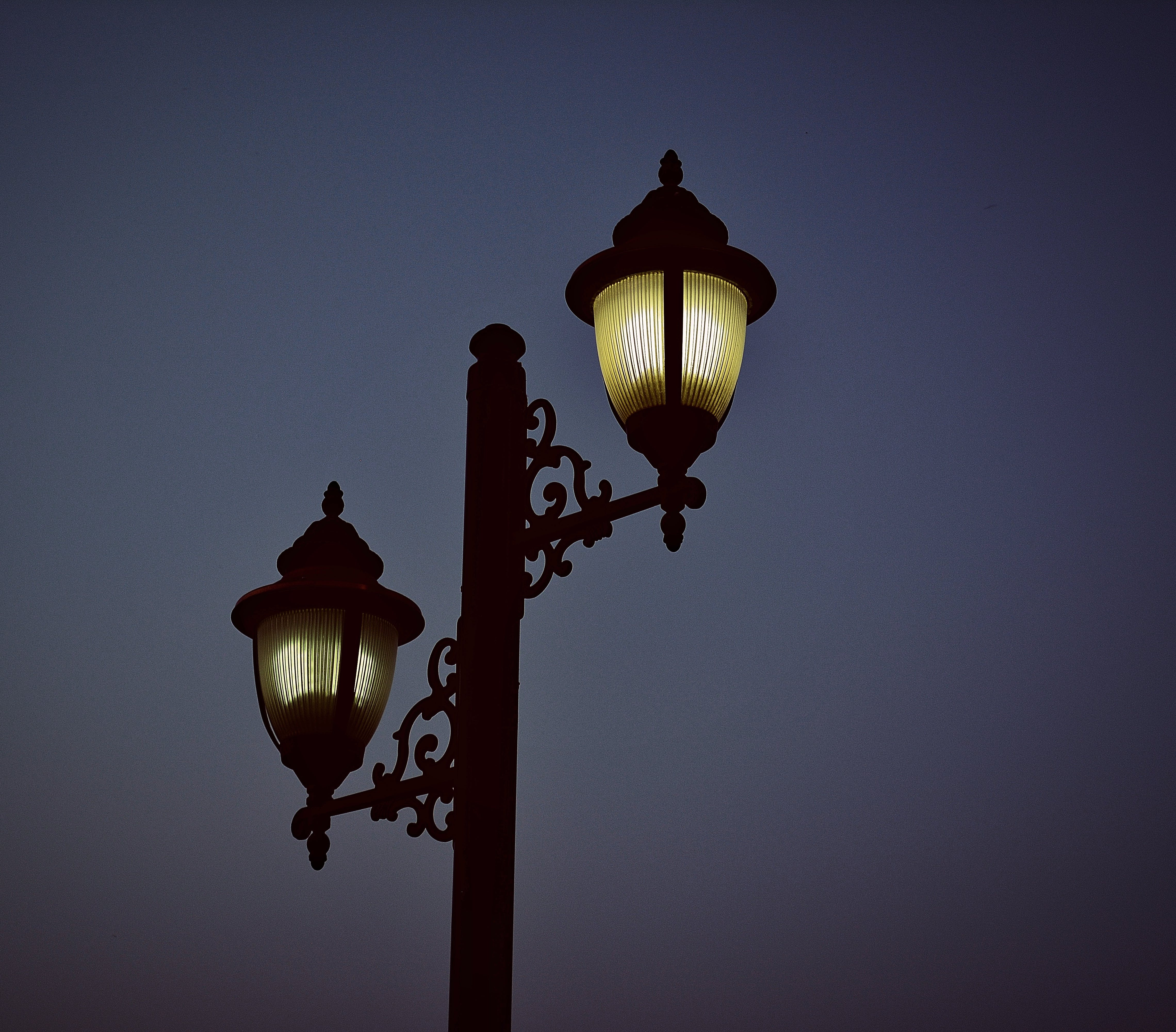 Photography of Black Metal Post Lamp During Night Time
