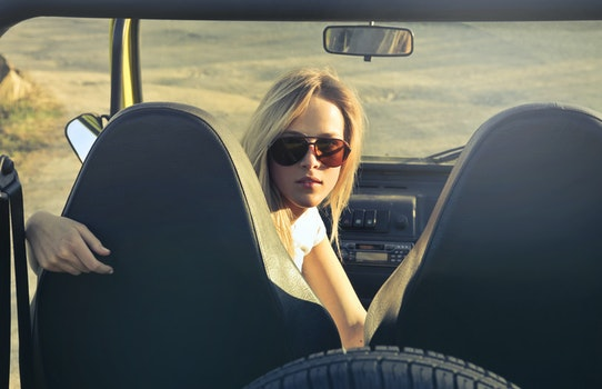 Woman Wearing Sunglasses Riding in Car