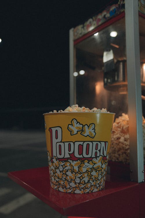 Close-Up Photo of a Yellow Bucket with Popcorn