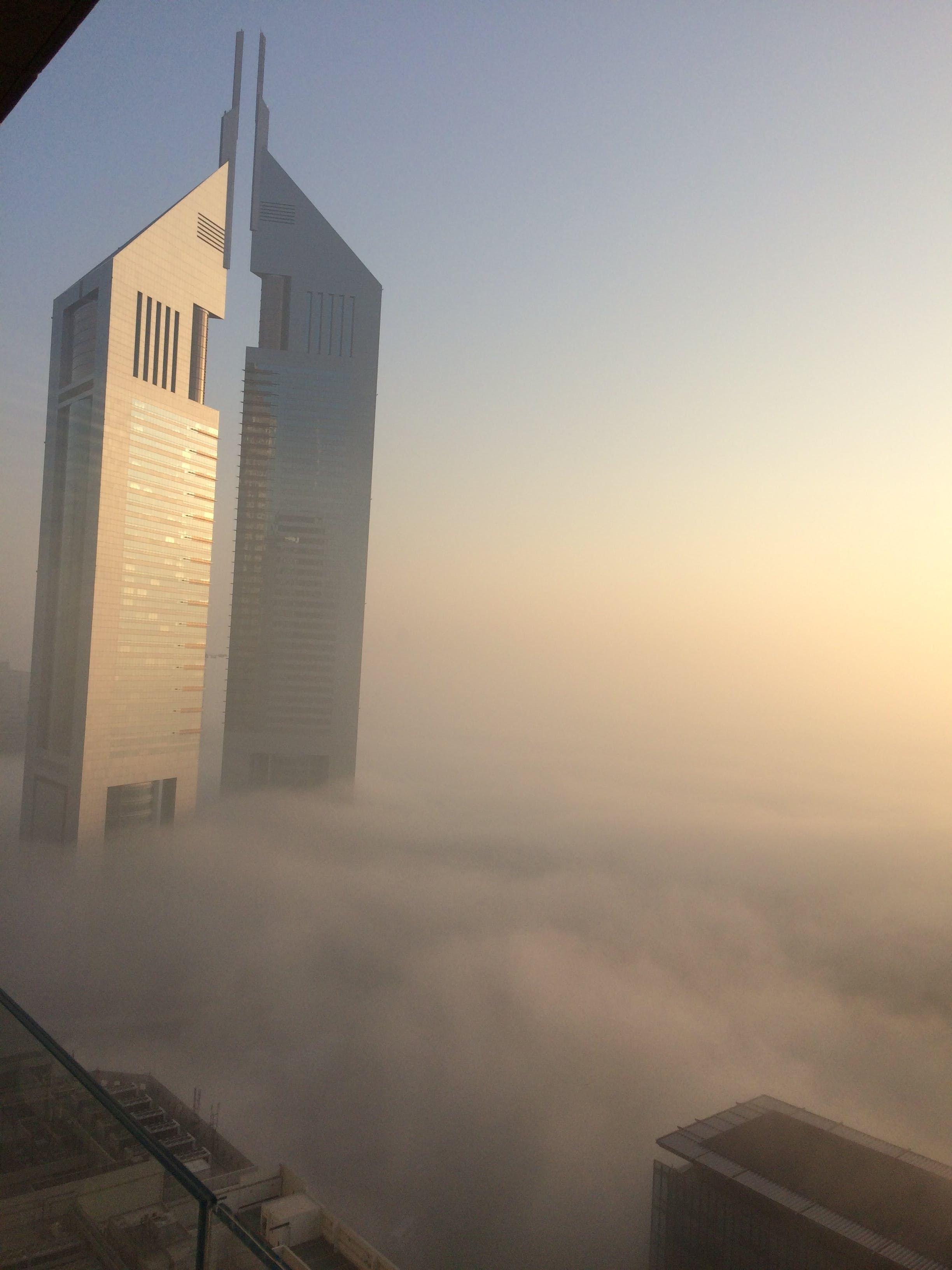 Free stock photo of Emirate tower blanketed with fog Dubai