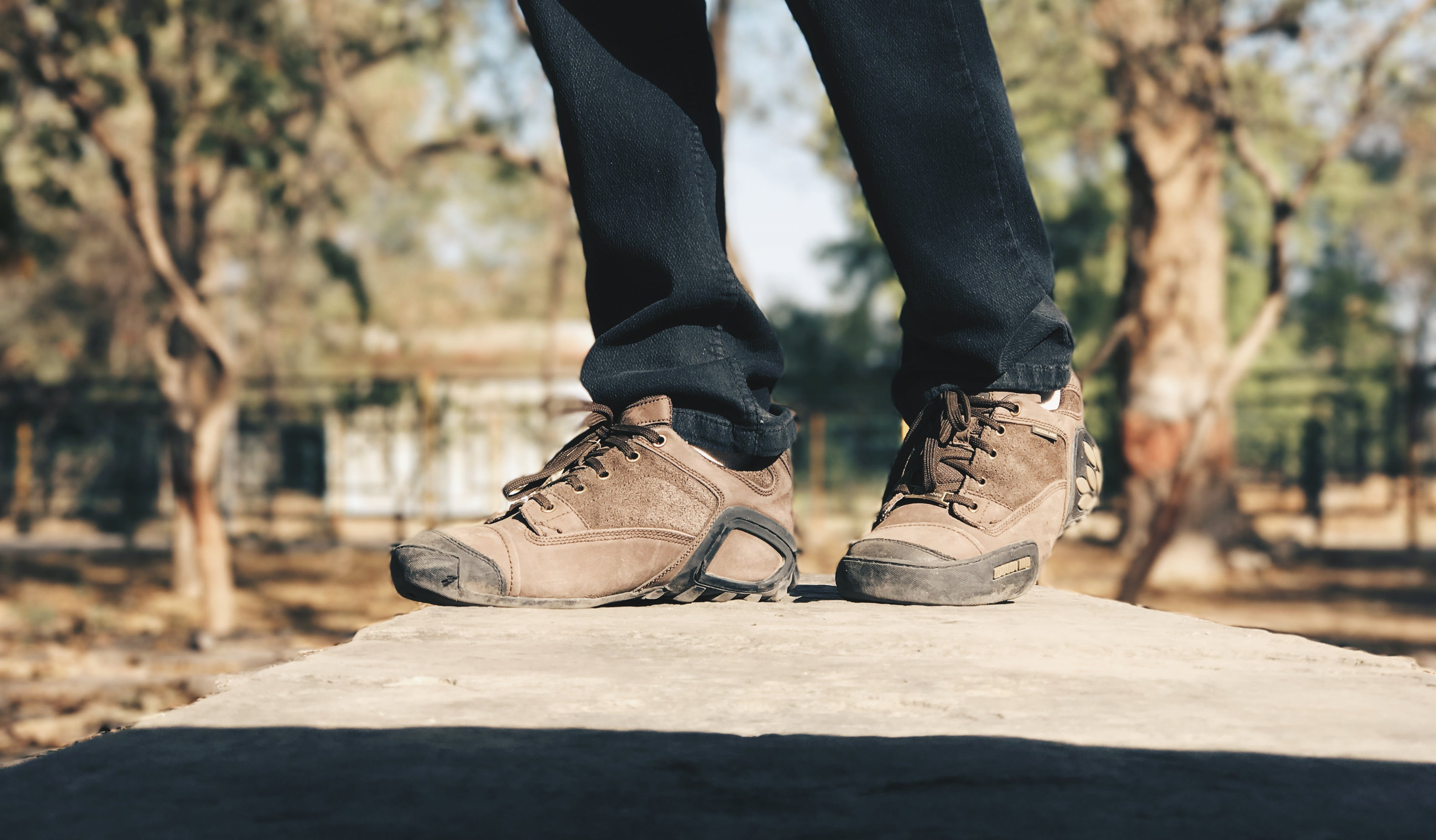 Selective Focus Photography of Person Wearing Brown Hiking Shoes